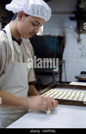 A cook at Al-Andalos Sweets in Aleppo in northern Syria preparing baklava before the civil war. - Stock Photo