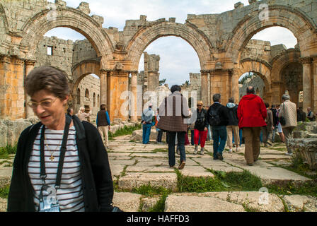 Tourists at the ruins at the Church of Saint Simeon Stylites, built in the the 5th century AD, before the civil - Stock Photo