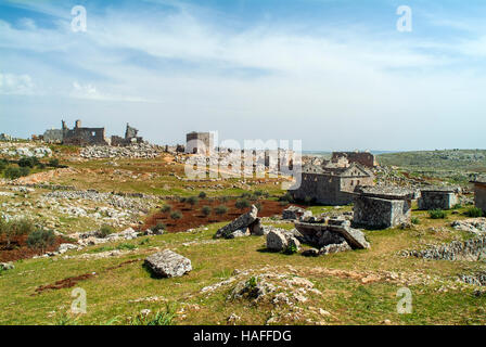 A view over the ruined town of Serjilla, one of the 'Dead Cities' in northwestern Syria. - Stock Photo
