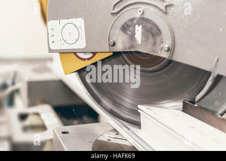 Circular Saw Cutting PVC Profile Close Up. Plastic Window and Door Industry Production. - Stock Photo