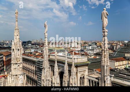 Spires overlooking city, Milan Cathedral (Duomo di Milano), Milan, Italy - Stock Photo
