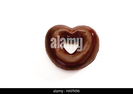 Heart-shaped gingerbread cookie with chocolate icing - Stock Photo