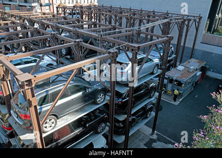 A multi level, stacked car parking system (called Edison ParkFast) in the Chelsea area of New York City, United - Stock Photo