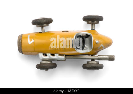 Vintage yellow toy racing car , top view on white background with natural shadow - Stock Photo