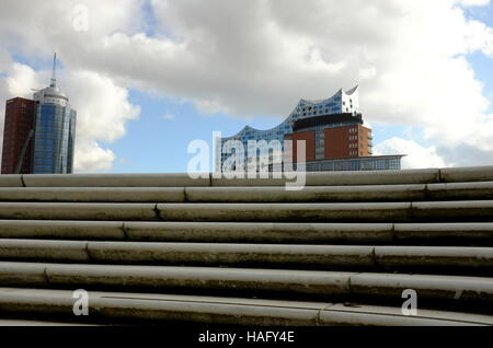 The new Elbphilahormnie music complex, opening in January 2017, juts out of the port seemingly into the spring sky. - Stock Photo