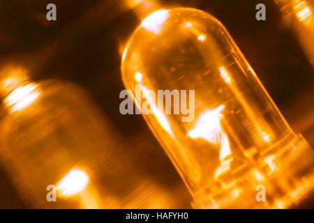 orange illuminated led in the dark closeup view - Stock Photo