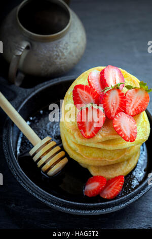 Stack of sweet pancakes with strawberry and honey. Gluten free flour. - Stock Photo