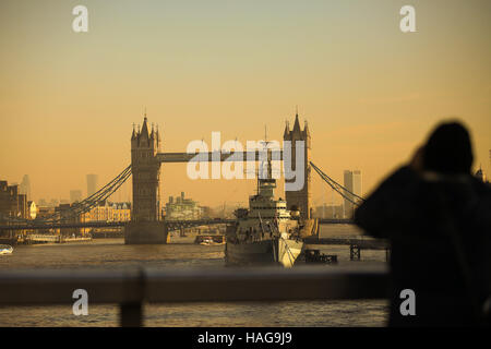 London, UK. 30th Nov, 2016. A man take a photograph of Tower Bridge on a cold but sunny day. Credit:  Dinendra Haria/Alamy - Stock Photo
