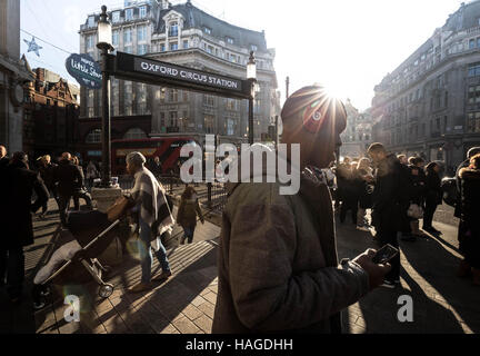 London, UK. 30th November, 2016. UK Weather: Winter sun on a busy afternoon on Oxford Street Credit:  Guy Corbishley/Alamy - Stock Photo