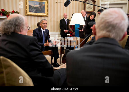 Washington, DC, USA. 30th Nov, 2016. President Obama, center, speaks as he meets with the 2016 American Nobel Prize - Stock Photo