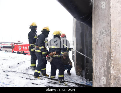 Qitaihe, China. 1st Dec, 2016. Rescuers work at the accident site in Qitaihe, northeast China's Heilongjiang Province, - Stock Photo