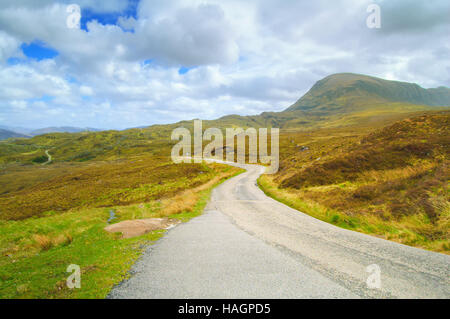 Highlands of Scotland narrow road in mountain landscape. Uk, Europe. - Stock Photo
