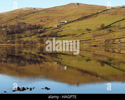 View & reflection of hills reservoir & Sleddale Hall (Crow Crag, Uncle Monty's Lake District cottage in cult film - Stock Photo