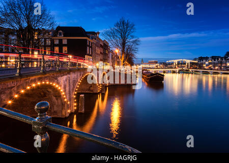 Amsterdam Canals and Bridges at Dusk - Stock Photo