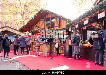 Bavarian style hut food stalls at the Christmas Market in Leicester Square, 2016, London, UK - Stock Photo