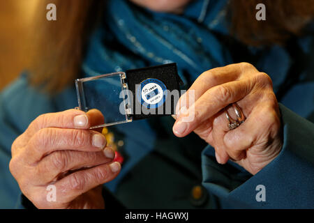 An NHS staff member collecting her 50 years service badge in Haywards Heath, East Sussex, UK. - Stock Photo