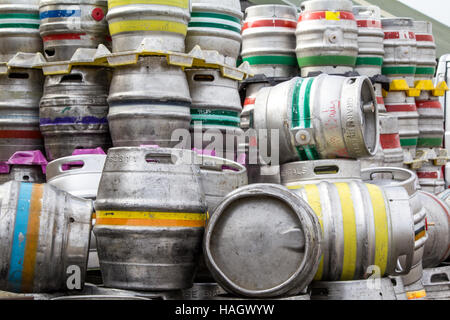 Stack of metal beer barrels awaiting delivery - Stock Photo