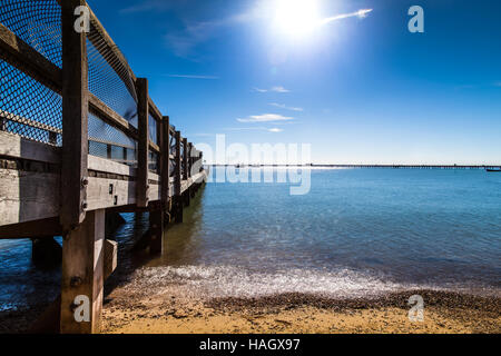 Jetty in Southend, Essex, with bright blue sky - Stock Photo