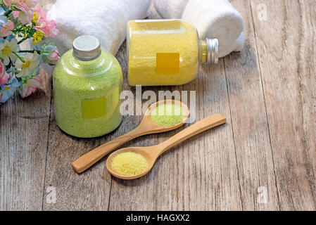 Homemade scrub made of sea salt and lemon on wooden background. - Stock Photo