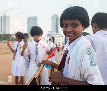 Group of school children on Galle Face Green in Colombo,Sri Lanka. - Stock Photo