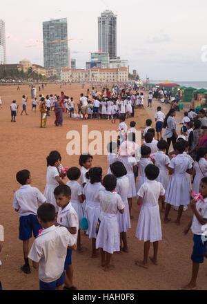 Group of schoolchildren on Galle Face Green, Colombo, Sri Lanka, - Stock Photo