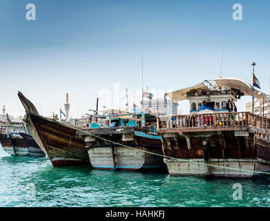 traditional old arabian wood dhow boats in deira harbour of dubai port UAE - Stock Photo
