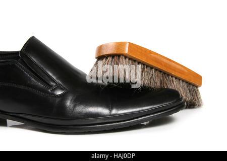 black leather shoe and brush - Stock Photo