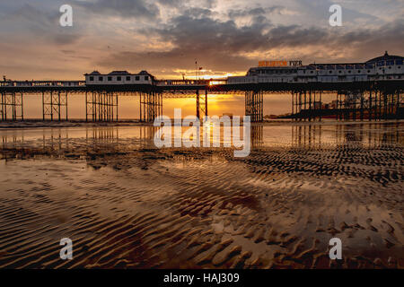 Low tide at Brighton Pier - Stock Photo