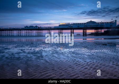Low tide near Brighton Pier - Stock Photo