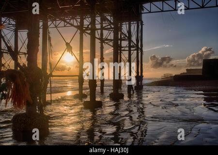 Under the Brighton Pier sunset - Stock Photo
