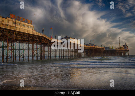 Brighton Pier with dramatic clouds - Stock Photo