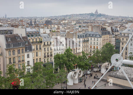 Paris view on a cloudy day, city centre and Basilica of the Sacred Heart of Paris in the distance. - Stock Photo