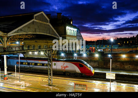 Virgin train at Preston Station on the West Coast line - Stock Photo