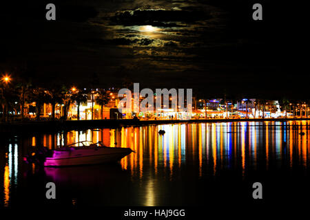 Night time with 'Supermoon' rising over Paphos Harbour,Cyprus - Stock Photo