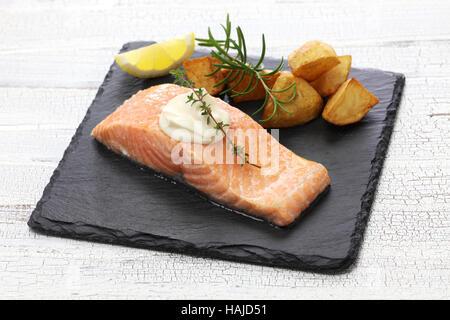 salmon steak with fried potatoes - Stock Photo