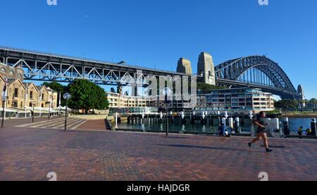 Sydney Harbour Bridge as view from The Rocks Sydney Cove at sunrise in Sydney, Australia. - Stock Photo