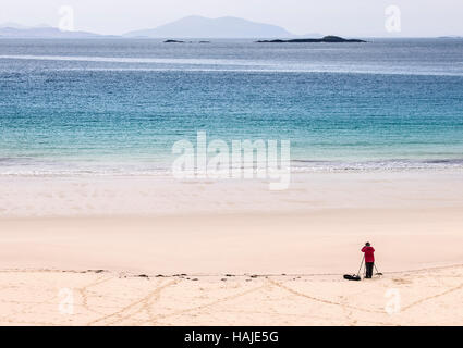 A photographer on the Hushinish beach, Harris, Hebrides, Scotland - Stock Photo