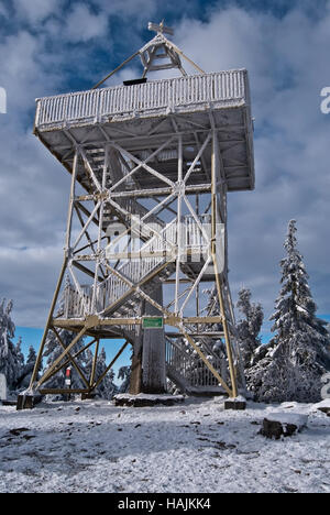 view tower on Barania Gora hill in Beskid Slaski mountains in Poland during winter day with blue sky and clouds - Stock Photo