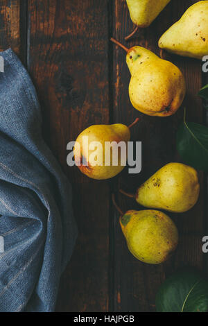 Fresh pears on a wooden surface - Stock Photo