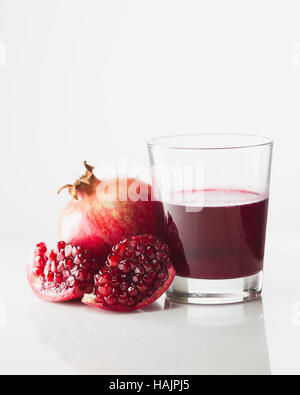 Pomegranate and glass of pomegranate juice - Stock Photo