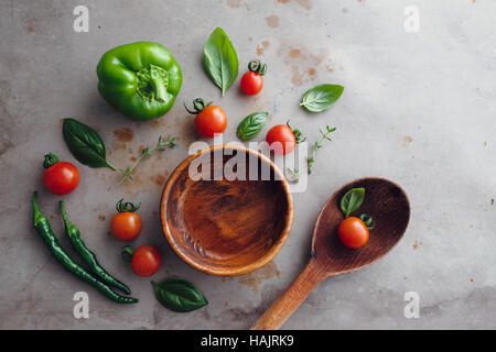 Wooden bowl with selection of fresh ingredients. - Stock Photo