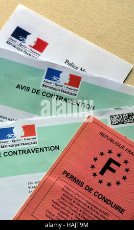 Notice of contravention and driving license - Stock Photo