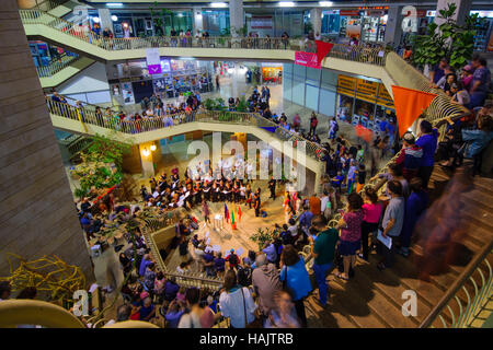 JERUSALEM, ISRAEL - SEPTEMBER 22, 2016: The Refurbished Clal Building, with choir singing performance and crowd, - Stock Photo