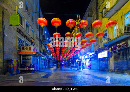 JERUSALEM, ISRAEL - SEPTEMBER 22, 2016: The Ben Hillel Street at night, with Chinese style decorations, locals and - Stock Photo