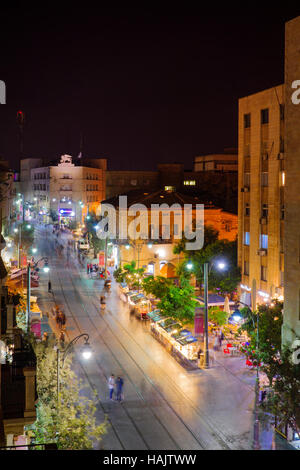 JERUSALEM, ISRAEL - SEPTEMBER 22, 2016: Night scene of Yafo Street, with locals and visitors, in Jerusalem, Israel - Stock Photo