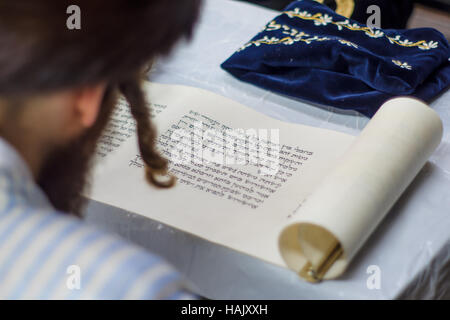JERUSALEM, ISRAEL - MAR 05, 2015: An ultra-orthodox Jew reads the book of Esther (the megillah), as part of the - Stock Photo