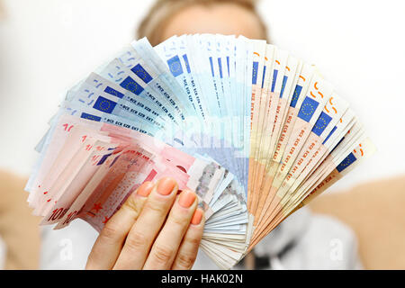 woman holds euro money banknotes in front - Stock Photo