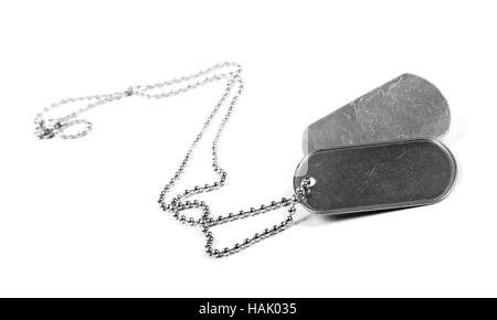 blank metal tags hanging on chain. isolated on a white - Stock Photo
