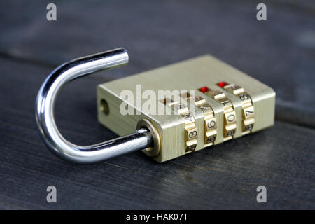 combination padlock on wooden table - Stock Photo