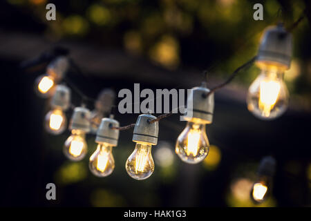 party string lights hanging in a line - Stock Photo